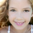 Beautiful little girl portrait smiling closeup fac — Stock Photo #5512687
