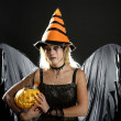 Woman dress for halloween and pumpkin - Stock Photo