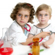 Girls pretending to be doctor in laboratory - Stockfoto