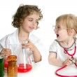 Girls pretending to be doctor in laboratory - Foto Stock