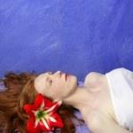 Beautiful redhead woman in massage blue board — Stock Photo #5512832