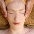 Beautiful woman portrait relaxing head massage — Zdjęcie stockowe