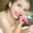 Little girl with lipstick on the bathroom — Stock Photo #5512971