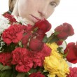 Beautiful woman holding a flowers bouquet — Stock Photo