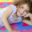 Stock Photo: Beautiful princess little girl smiling lying floor