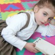 Beautiful preschooler girl studying book — Stock Photo #5513055