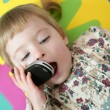 Funny toddler girl talking mobile cell phone — Stock Photo