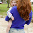Redhead mother and blond daughter playing — Stock Photo #5513177