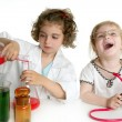 Girls pretending to be doctor in laboratory — Stockfoto