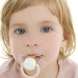 Baby toddler blond hair blue eyes and pacifier — Stock Photo #5513196