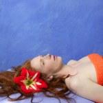 Beautiful redhead woman in massage blue board — Stock Photo