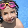 Beautiful little girl smiling in   pool — Stok fotoğraf