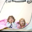 Camping tent vacation with two little girls — Stock Photo