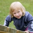 Blond adorable little girl playing playground — Stock Photo #5513413