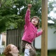 Daughter and mother playing on playground — Stock Photo