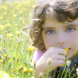 Adorable little girl smell flower in meadow — Stock Photo