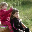 Little sister girls hairdresser on the river — Foto Stock