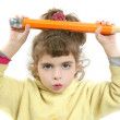 Little girl serious with big pencil in hand — Stock Photo