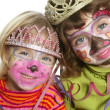 Party little two sisters with painted happy face — Stock Photo