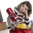 Student little girl with microscope and laptop - Foto de Stock