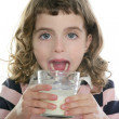 Brunette little girl drinking glass of milk — Stock Photo #5513602