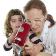 Photo: Doctor woman teacher and pupil microscope