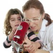 Foto Stock: Doctor woman teacher and pupil microscope