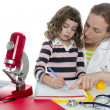 Stock Photo: Doctor natural sciences teaching school pupil