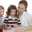 Doctor natural sciences teaching school pupil — Stock Photo