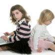 Two little girls sister with computer laptops — Stock Photo