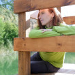 Redhead woman looking at river — Stock Photo