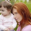 Beautiful mother and baby little girl outdoor — Stock Photo