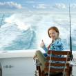 Fisherwoman big game on boat chair ok sign — Stock Photo