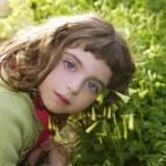 Little girl hug grass happy in green meadow — Stock Photo #5513909