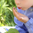 Little girl palying with silkworm in hands — Stock Photo #5513915