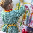 Artist little girl children painting abstract picture - Stock Photo