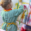 Artist little girl children painting abstract picture - Stockfoto