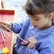 Artist school little girl painting watercolors portrait — Stock Photo