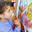 Artist little girl children painting abstract picture - Stok fotoraf