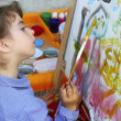 Artist school little girl painting watercolors portrait - Stockfoto