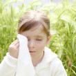 Sad little girl crying outdoor green meadow field — Stock Photo #5513954