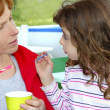 Mother and daughter eating ice cream talking — Stock Photo