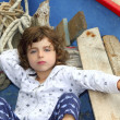 Little girl having rest on traditional balearic boat - Stockfoto