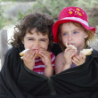 Hungry sisters summer cold day wrap big jacket - Stock Photo