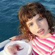 Girl with two jellyfish in white dish boat blue sea — Stock Photo #5514076