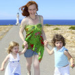Mother two daughter sister running happy — Stock Photo #5514084