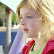 Beautiful blond little girl children portrait in park - Stock Photo