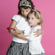 Two sisters little girl friends hug stand — Stock Photo #5514103