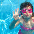 Underwater little girl pink bikini blue swimming pool — Stock Photo