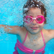 Royalty-Free Stock Photo: Underwater little girl pink bikini blue swimming pool